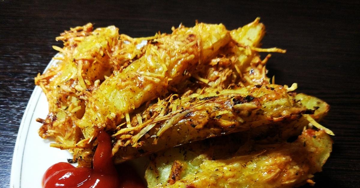 Хрустящие картофельные дольки в пармезане фото